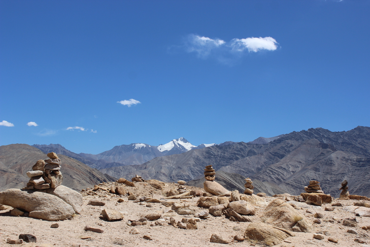 Stone piles on the plateau above Basgo. Stok Kangri in the distance